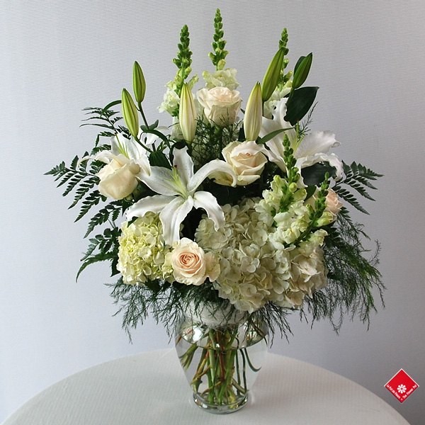 Fleurs blanches pour condoléances à Montréal · Le Pot de Fleurs